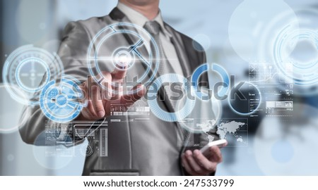 Business man in blue grey suit using digital pen working with digital virtual screen business concept of marketing strategy plan - stock photo