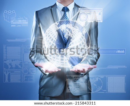 Business man in blue grey suit working on digital virtual screen, business concept of marketing strategy plan - stock photo