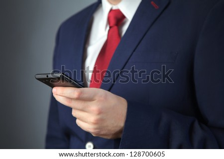 business man in blue suit with mobile phone