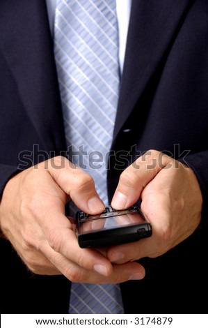 business man in blue suit working on pda or smartphone - stock photo