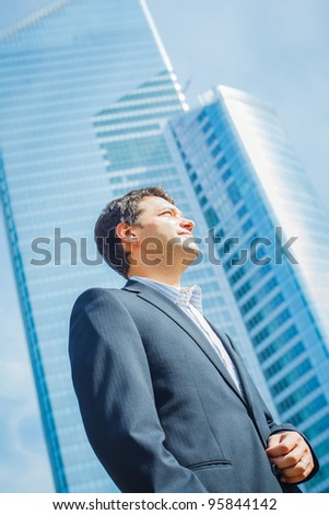 business man in business center looking to the future - stock photo