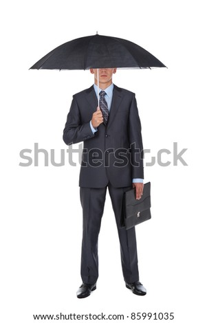 Business man in elegant modern suit hold an umbrella, isolated over white background - stock photo