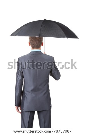 Business man in elegant modern suit hold an umbrella standing back, isolated over white background. Empty copy space. Concept. - stock photo