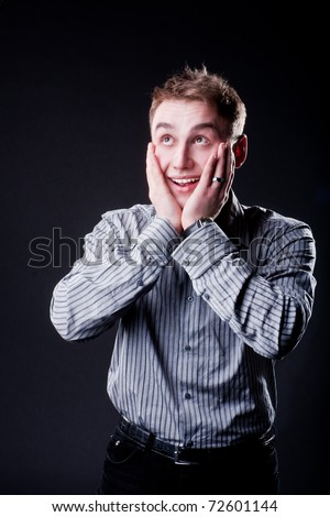 business man in funny shirt and tie surprise and laughing with open mouth