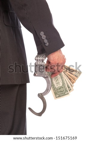 Business man in handcuffs arrested for bribe, isolated on white - stock photo