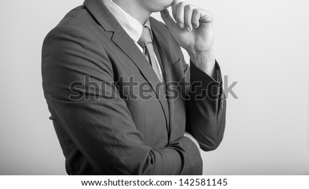 business man in modern elegant suit standing back, isolated over white background. Concept of idea,