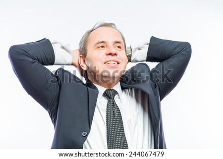 business man in office relaxing with hands behind his head
