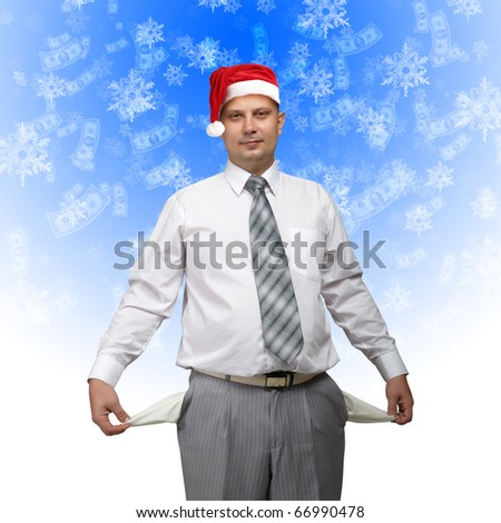 business man in santa hat with ampty pocket