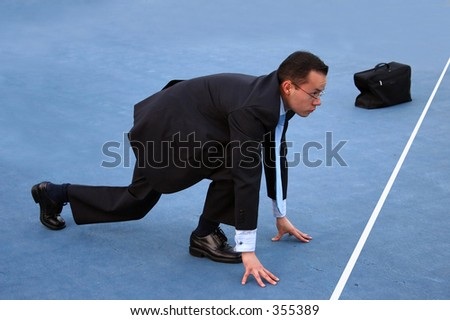 business man in start - racing position - stock photo