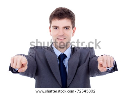 business man in suit and tie pointing the fingers in front of himself - stock photo