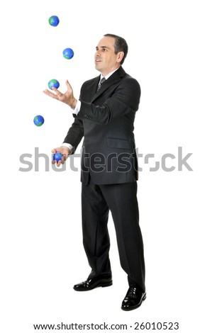 Business man in suit juggling planet earth balls