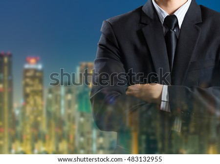 Business man in suit on city background