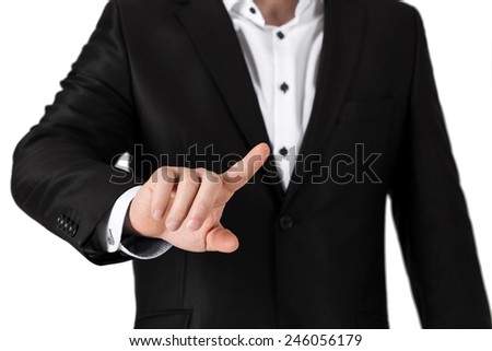 Business man in  suit pressing on blank button. Isolated on white