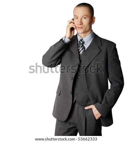 business man in suit speaking by the phone - stock photo