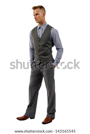 Business man in suit standing with hands in his pocket isolated on a white background. - stock photo