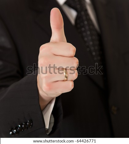Business man in suit thumbs up on white isolated background