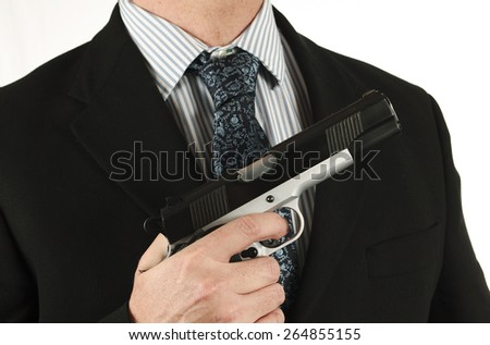 Business man in suit with a gun