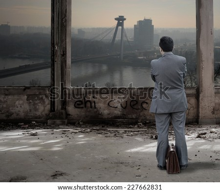 Business man in the abandoned building - stock photo