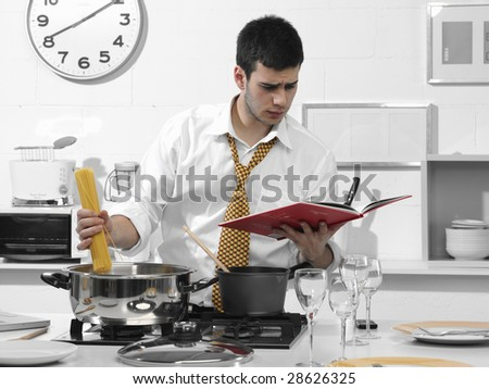 business man in the kitchen preparing dinner - stock photo