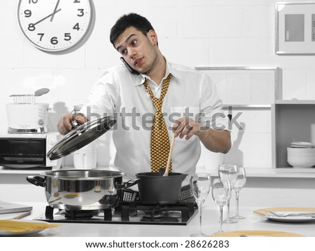 business man in the kitchen talking on the phone - stock photo