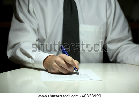 business man in white shirt signing contract - stock photo