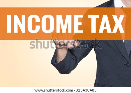 Business man Income Tax word touch on virtual screen orange background - stock photo