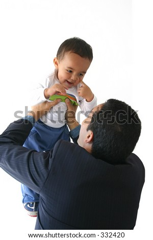 business man interacting with his son - stock photo
