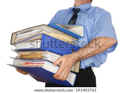 business man is carrying many different folders - stock photo