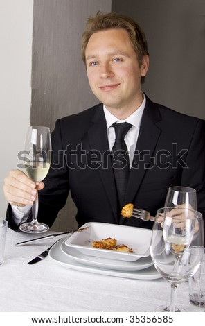 Business man is having lunch at a French gourmet restaurant.