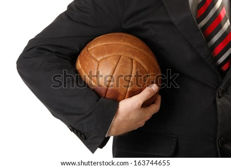 Business man is holding ball for soccer or football  - stock photo