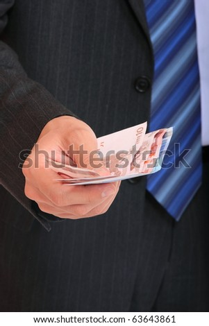 Business man is paying with euro banknotes - stock photo