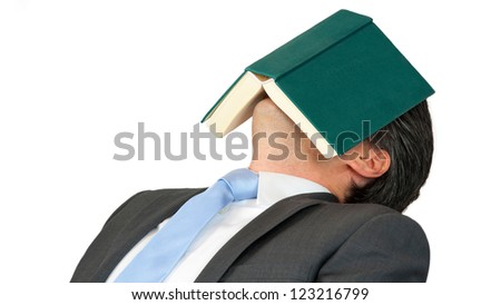 Business man is sleeping after reading a book - stock photo