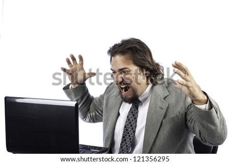 Business man isolated on white getting angry at the laptop - stock photo