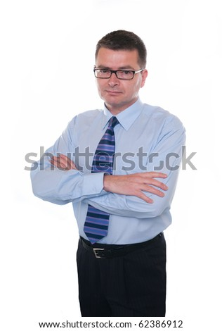 Business man isolated on white. Looks seriously at camera. Arms folded. - stock photo