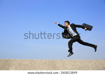 business man jump and run with blue sky background, full length, asian male - stock photo