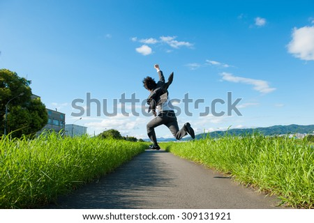 business man jump with blue sky, full length, asian male