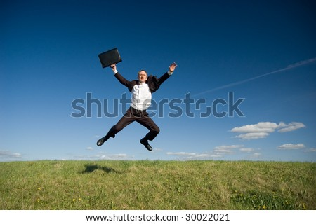 Business man jumping - stock photo