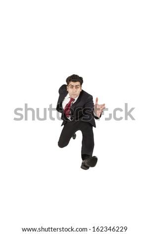 Business man jumping and running forward - stock photo