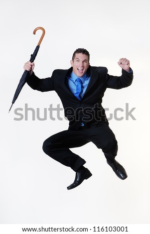 business man jumping in the air holding a umbrella