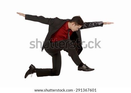 Business man jumping isolated over white background - stock photo
