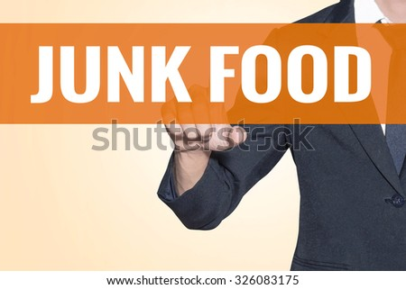 Business man Junk Food word touch on virtual screen orange background - stock photo