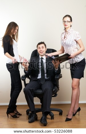 business man leading a team in an office environment smiling