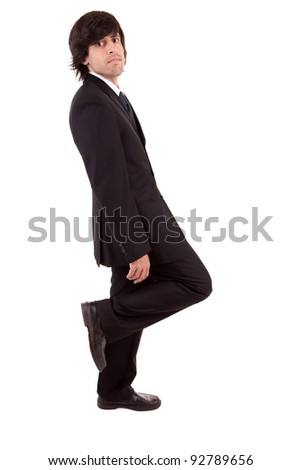 Business man leaning against wall, isolated over white