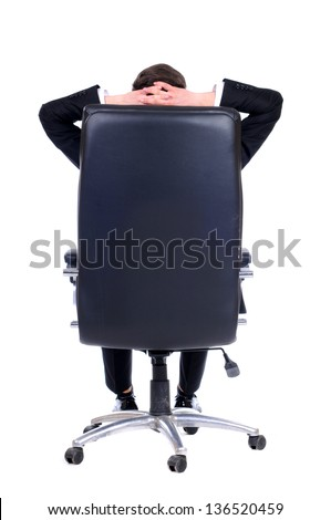 Business man leaning back in the chair , dreaming on white background - stock photo
