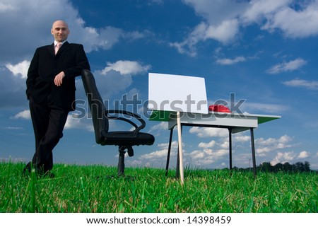 Business man leaning on a chair in an outdoor office.  Blank sign for copy.Available space for text. - stock photo