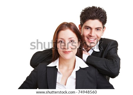 Business man leaning on the shoulders of a female colleague - stock photo