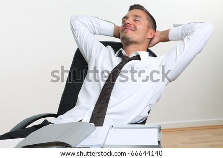 business man leans in office