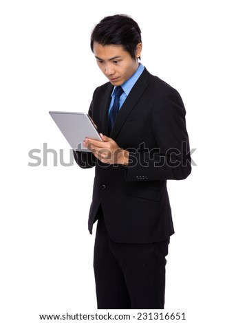 Business man look at digital tablet