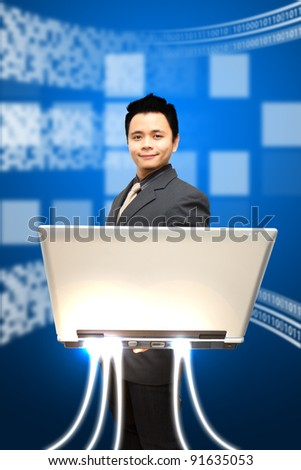Business man look at notebook computer and digital background
