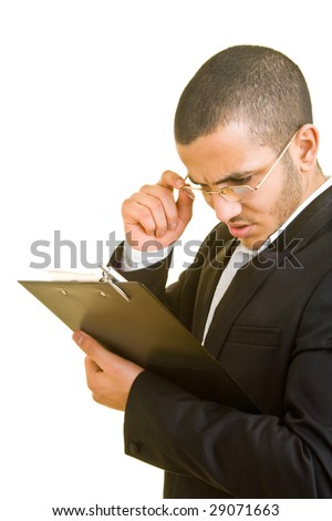 Business man looking at a checklist - stock photo